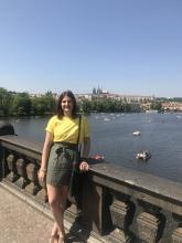 Taylor poses on a bridge in Prague
